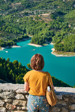 Woman Looks At The Guadalest Reservoir In Spain