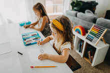 Two Young Girls Drawing With C...