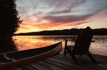 Canoe And Adirondack Chair On ...