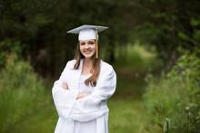 Smiling Female Graduate Wearin...