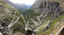 A Windy Road In A Valley In Trollstigen, Norway
