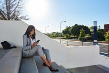 Businesswoman Sitting On Some ...