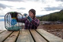 A Norwegian Fisherman Inspects...
