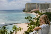 Smiling Girl Enjoys Waikiki Ocean View From Hotel Balcony (tilt Shift)