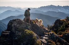 Male Hiker And Dog In The Casc...