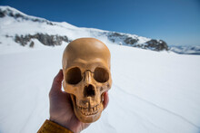 Man Holds Human Skull, Artifac...