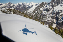 Shadow Of Helicopter Seen On Snowy Mountain Landscape