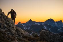 Hiker Navigates A Mountain Rou...