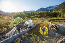 Young Boy Exploring Near Campsite In Mountains, Whistler, B.C.