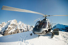 Helicopter Landed On Mountain Ridge During Winter.