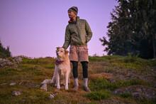 Hiker In Puffy Coat Scratching...