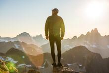 Lone Hiker On Mountain Summit ...