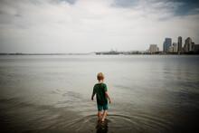 Six Year Old Boy Wading In Coronado Bay San Diego Skyline