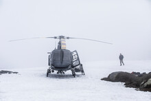 Helicopter Pilot Waits For Imp...