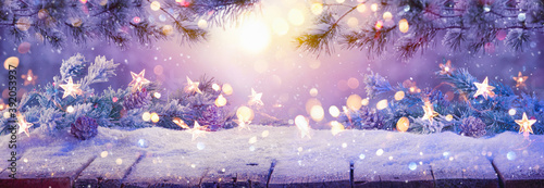 Photo Winter Sunny Landscape with Spruce Branches. Christmas Decoration