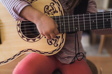 Ornate 6-string Acoustic Guitar Held By 6 Yr Old Child