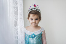 4 Yr Old In Princess Gown Standing By Lace Curtain Wearing Tiara