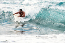 Man Surfing With Yellow Surfboard