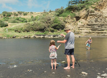 Family Fishing At A Scenic River Spot