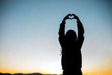 Hands Form A Heart For Love Silhouette With Sunset Or Sunrise