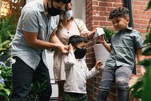 Parents Helping Young Kids Put...