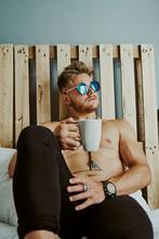A Blond Man With Blue Sunglass...