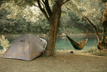 Tent And Hammock By The River