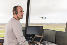Male Dispatcher Controlling Flights In Airport