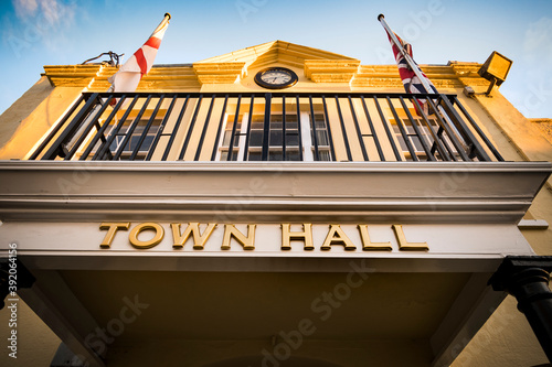 Obraz Looking up at town hall in early evening sunshine - fototapety do salonu