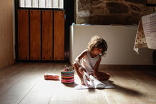Ethnic Child With Coloring Book