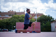 Man Trains His Legs With Power Lunges In A Park Outdoors