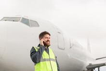 Male Technician Speaking On Sm...
