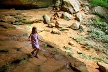 A Small Child Walks Down A Sto...