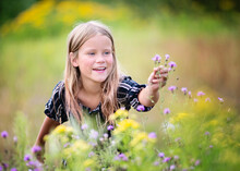 Young Blond Girl In Field Of F...