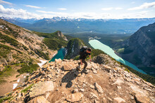 Hiker Climbing Up Devil's Thumb Peak In Lake Louise Banff