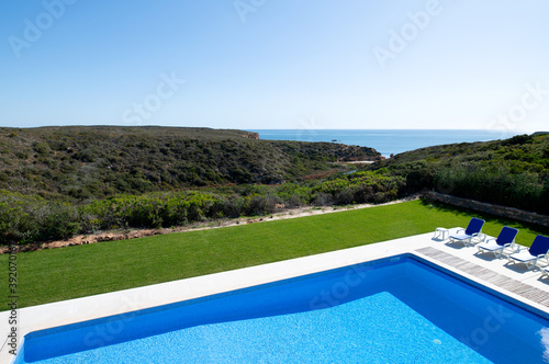 Slika na platnu High angle view of a swimming pool in the garden of a holiday villa with views a
