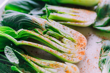 Spiced Close Up Fresh, Juicy Bokchoy Sliced In Half