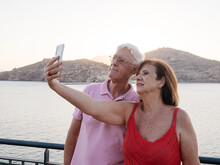 Relaxed Senior Couple Taking A Selfie To Remember With The Seaport Beh
