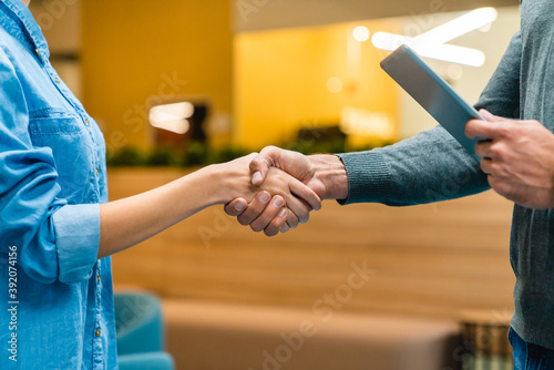 Close up photo of shaking hands in office