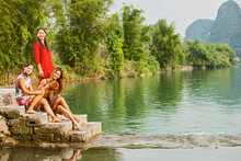 Three Beautiful Women Posing Next To The River Li In Yangshuo