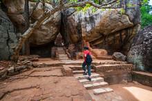 Woman Climbing Up The Stairs Towards The Rock Fortress Of Sigiriya