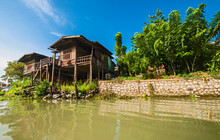 Stilt Houses Next To The River In Ayutthaya