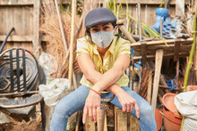 Young Hipster Woman Using Mask Face Taking A Break After Gardening