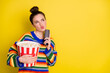 Photo of young attractive woman think hold remote control eat pop-corn look empty space isolated over yellow color background