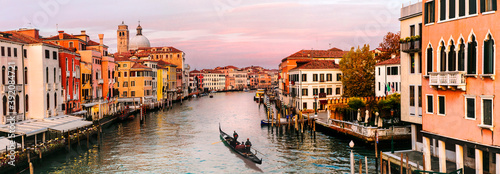 Romantic Venice town over sunset. View from bridge Skalzi for Grand canal. Italy travel and landmarks