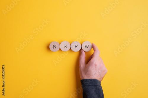NSFW abbreviation spelled on wooden cut circles Canvas Print