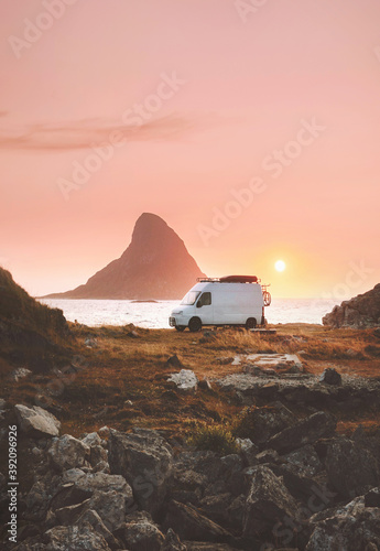 Fotografija Van car camper at sunset ocean beach road trip in Norway caravan RV trailer trav