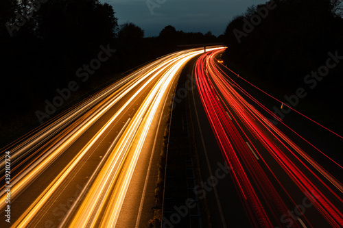 Slika na platnu Beautiful and colorful long exposure of the driving cars on the highway at night
