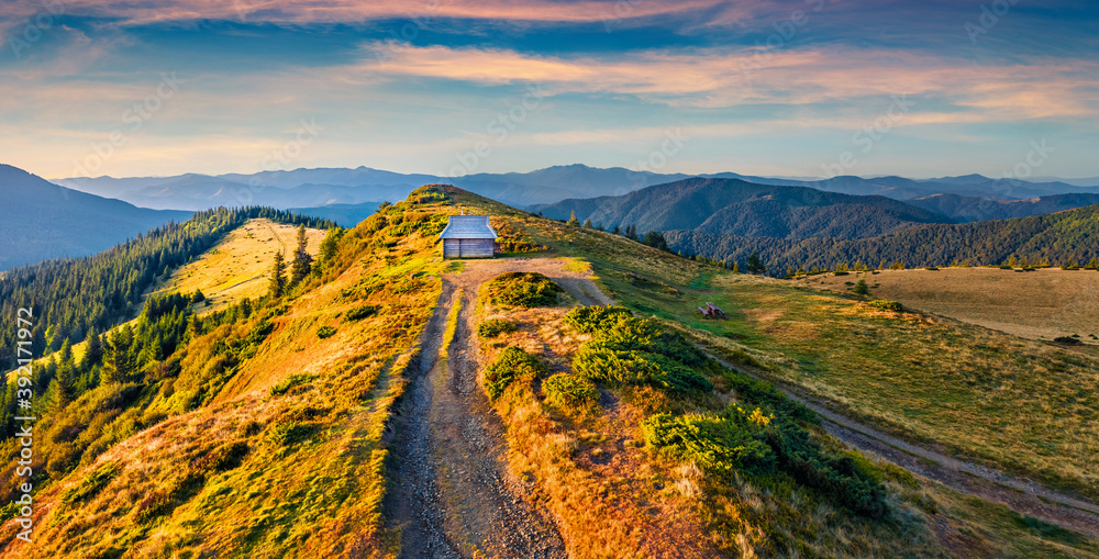 Fototapeta Colorful morning scene of the tourist shelter. Majestic autumn view from flying drone of Carpathian mountains, Ukraine, Europe. Beauty of nature concept background. .