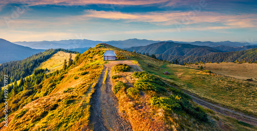 Colorful morning scene of the tourist shelter. Majestic autumn view from flying drone of Carpathian mountains, Ukraine, Europe. Beauty of nature concept background. .